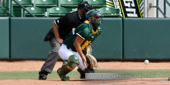 Mike Falkins positions himself to block an errant pitch